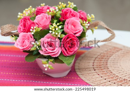 flower vase with beautiful red flowers. artificial flowers. - stock photo
