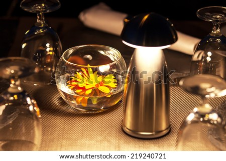 Flower with romantic lighting decorate on a dinner table - stock photo
