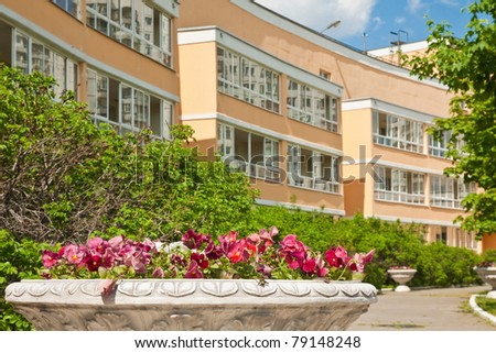 Flowerbed against of new urban apartment house