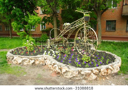 flowerbed in an apartment house  yard - stock photo
