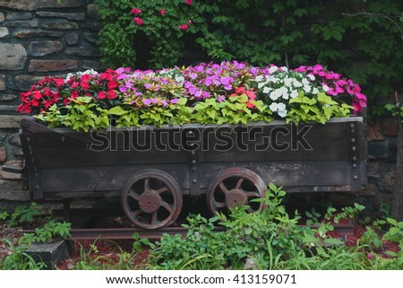 Flowerbed On Wagon - stock photo
