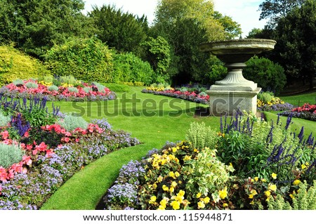 Flowerbeds, Grass Pathway and Ornamental Vase in a Formal Garden