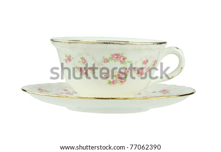 Flowered antique tea cup and saucer isolated on a white background with clipping path. - stock photo