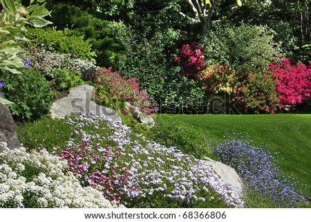 Flowering rock garden in spring. More images of this award winning garden in my portfolio. Also available in vertical. - stock photo