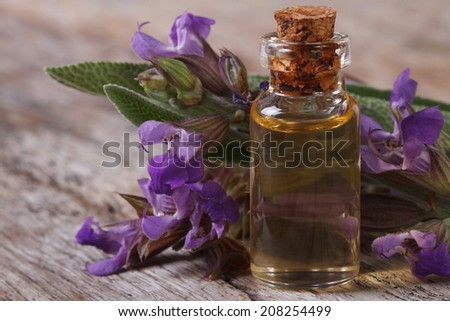 flowering sage and fragrant oil close-up on the table. horizontal