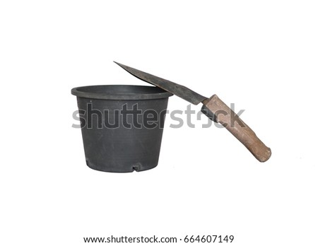 flowerpot and shovel on white background