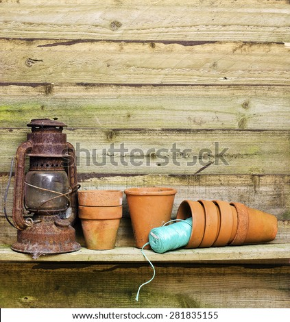 Flowerpots in garden shed; gardening paraphernalia in potting shed; excellent copy space  - stock photo