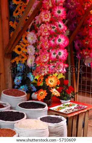 Flowers and Beans for Sale in a market in Chiapas, Mexico - stock photo