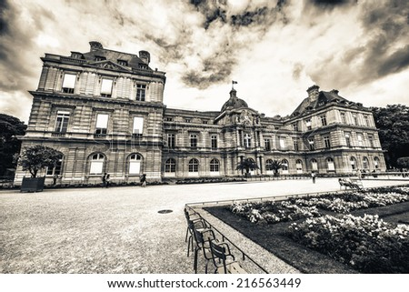 Flowers and buildings of Luxembourg Gardens in Paris. - stock photo