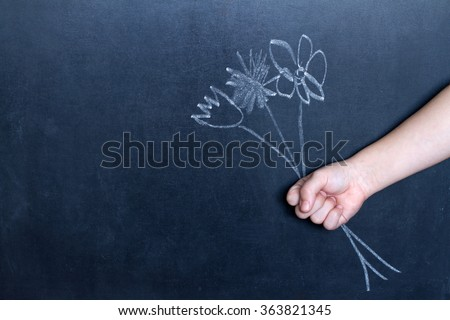 Flowers and child's hand abstract background concept - stock photo