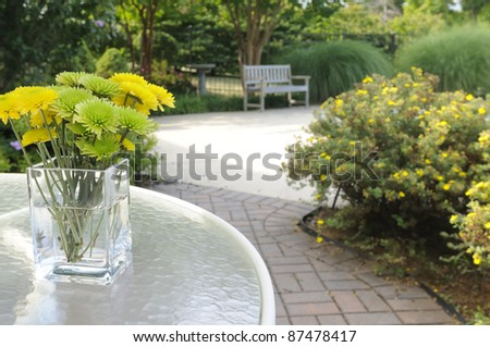 Flowers and Garden Bench - stock photo