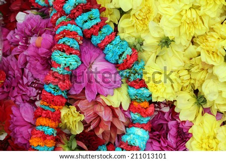 Flowers and garlands for sale at the flower market in the shadow of the Haora Bridge in Kolkata, West Bengal, India - stock photo