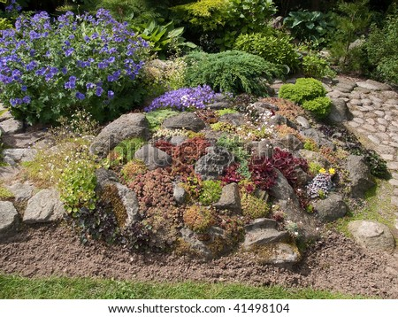 Flowers and plants corner in a beautiful garden - stock photo