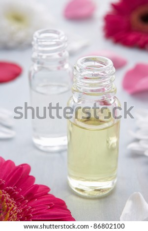 Flowers and scent bottle - stock photo
