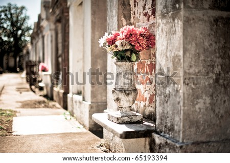 Flowers and Tombs in Lafeyette Cemetery - stock photo