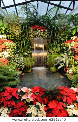 Flowers and waterfall inside the historic butchart gardens, vancouver island, british columbia, canada - stock photo