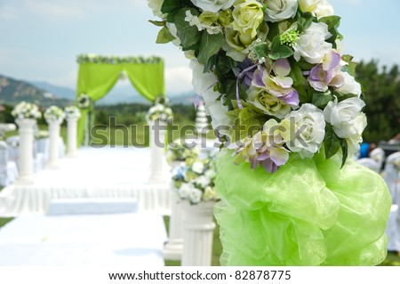 Flowers at an outdoor wedding venue - stock photo