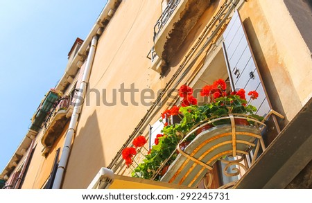 Flowers at the window of the Italian home - stock photo
