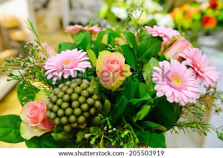 flowers bouguet with pink gerbera in flower shop - stock photo