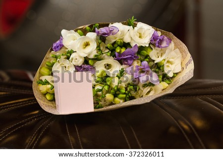 Flowers bouquet of freesia in interior - stock photo