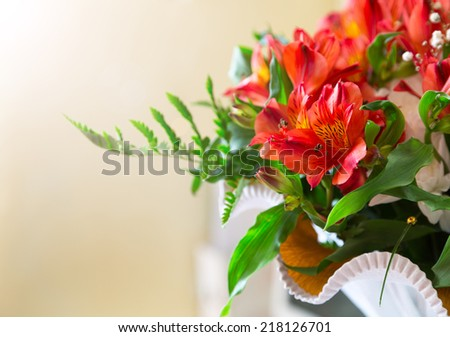 flowers bouquet red alstroemeria arrange for decoration in home, selective focus, sunlight - stock photo