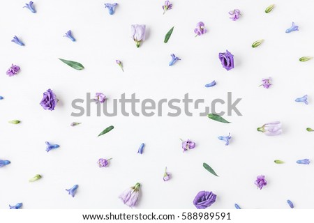 Flowers composition. Frame made of various colorful flowers on white background. Flat lay, top view.