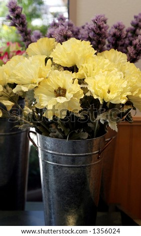 Flowers in a can. - stock photo