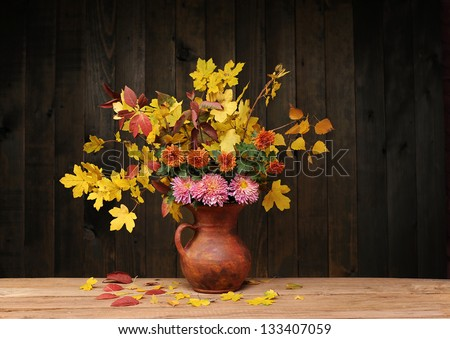 Flowers in a ceramic vase on the table