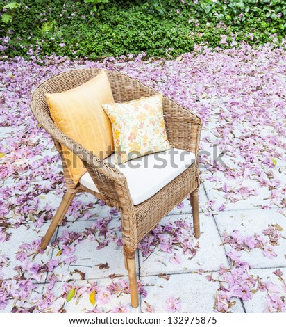 flowers in a garden chair. - stock photo