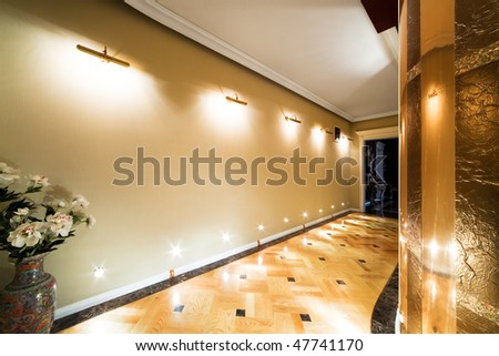 flowers in a long corridor with parquet flooring