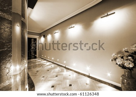 flowers in a long corridor with parquet flooring - stock photo