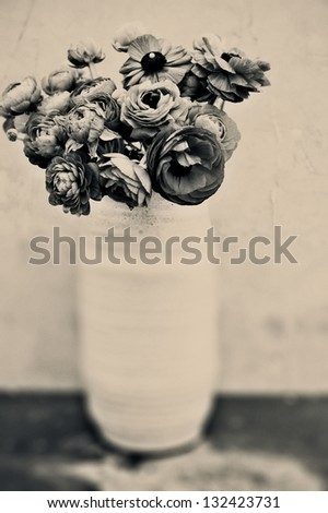 Flowers in a vase. Black and white sepia toned fine art photograph.