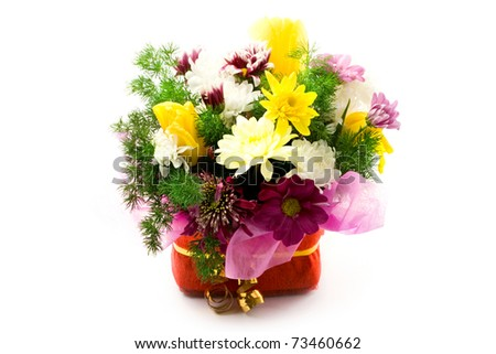Flowers in basket isolated on white