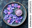 Flowers in blue bowl with sea �¢??�¢??salt for SPA - stock photo