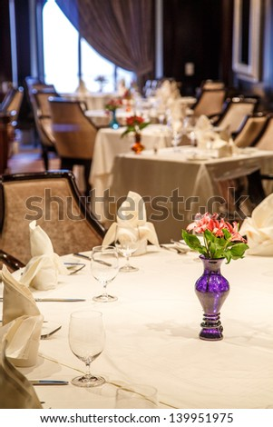 Flowers in blue vase in a formal dining room