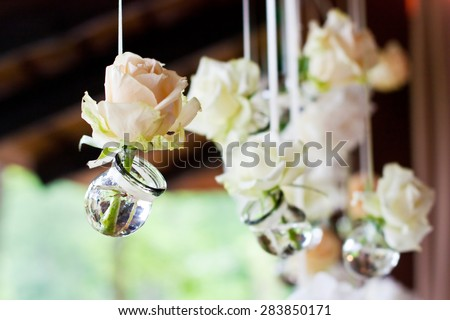 Flowers in bulbs hang in a wedding party - stock photo