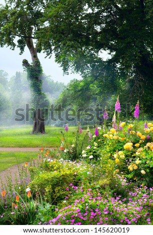 flowers in the morning in an English park - stock photo