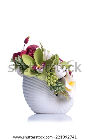 flowers in the white pot on isolated background with reflection - stock photo
