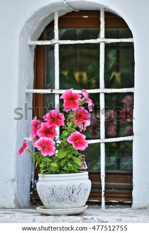Flowers in windows of the medieval monastery