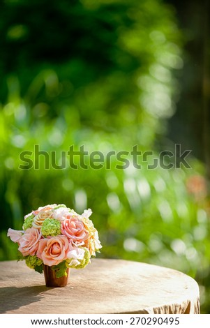 Flowers including Roses, mini Hydrangea, Sweet Pea on a table - stock photo