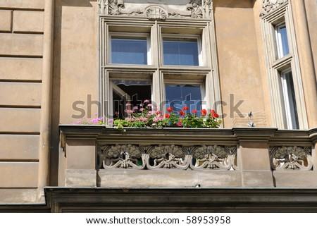 Flowers on a European balcony. - stock photo