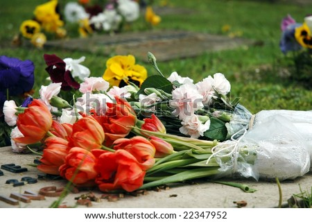 flowers on a grave - stock photo
