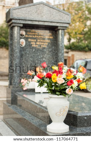 Flowers on a marble grave - stock photo