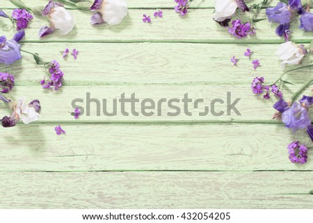 flowers on green wooden background - stock photo