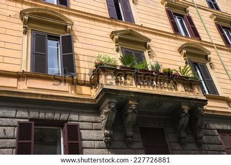 Flowers on the balcony of the beautiful Italian home - stock photo