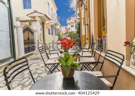 flowers on the table of a cafe in Preveza city, Greece - stock photo