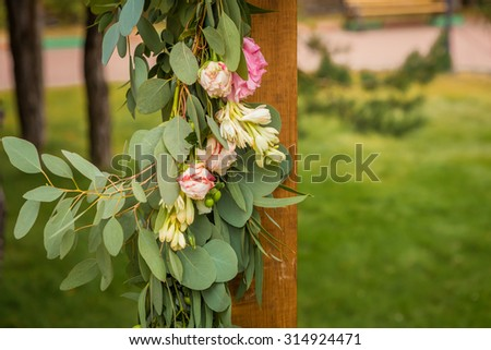 flowers on the wedding arc - stock photo