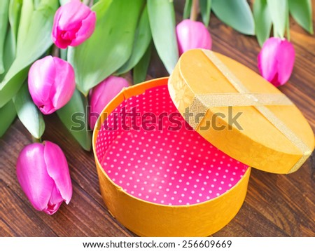 flowers on the wooden table, spring background - stock photo