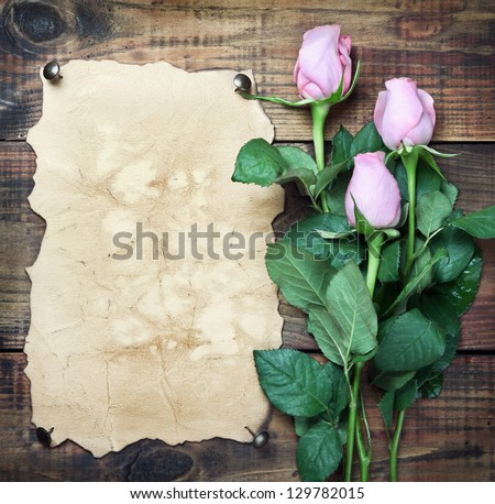 Flowers on vintage wood background with blank - stock photo