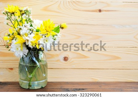 Flowers on wooden table with place for your text